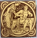 yellow and brown tile showing shoemaker seated while woman looks on