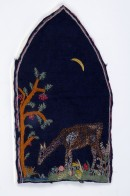 dark blue fabric with embroidery of deer and tree