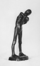 Nude boy standing with feet placed apart, the upper torso bending slightly to the right and downward, the arms held in front of the body and wrapped around one another, the head resting pensively on the upper arm. Front view.