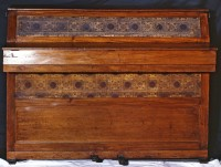 Upright piano with decorative panels